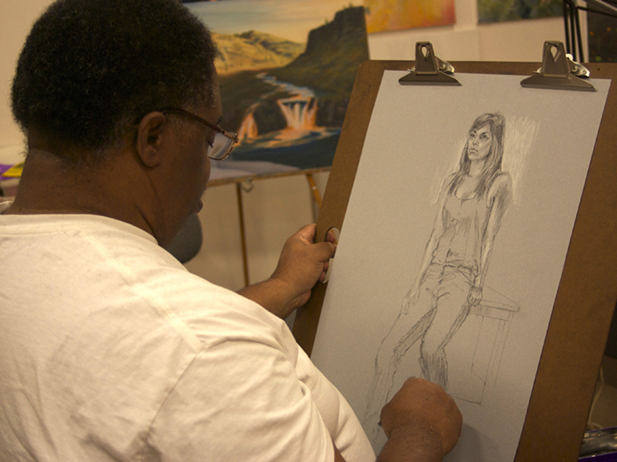 Dennis Lewis drawing from a live model.