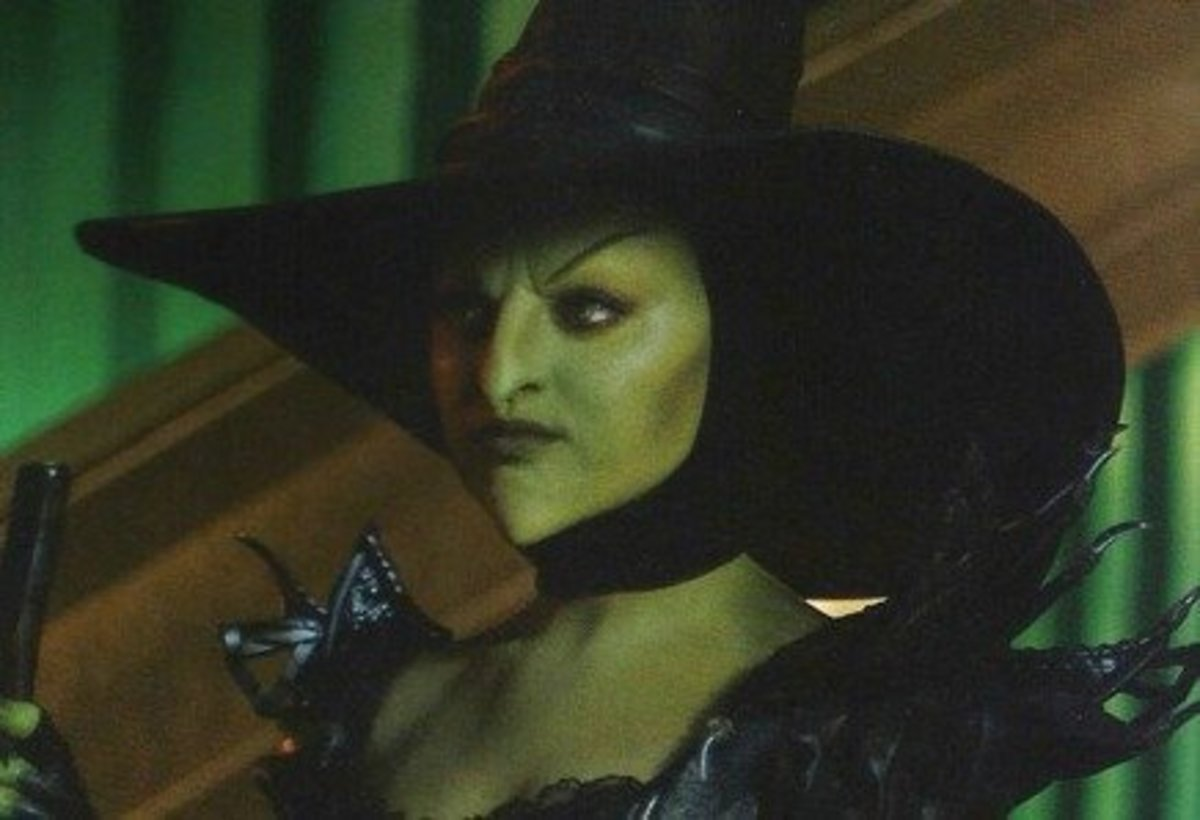 Mila Kunis dressed as Theodora, the Wicked Witch of the West