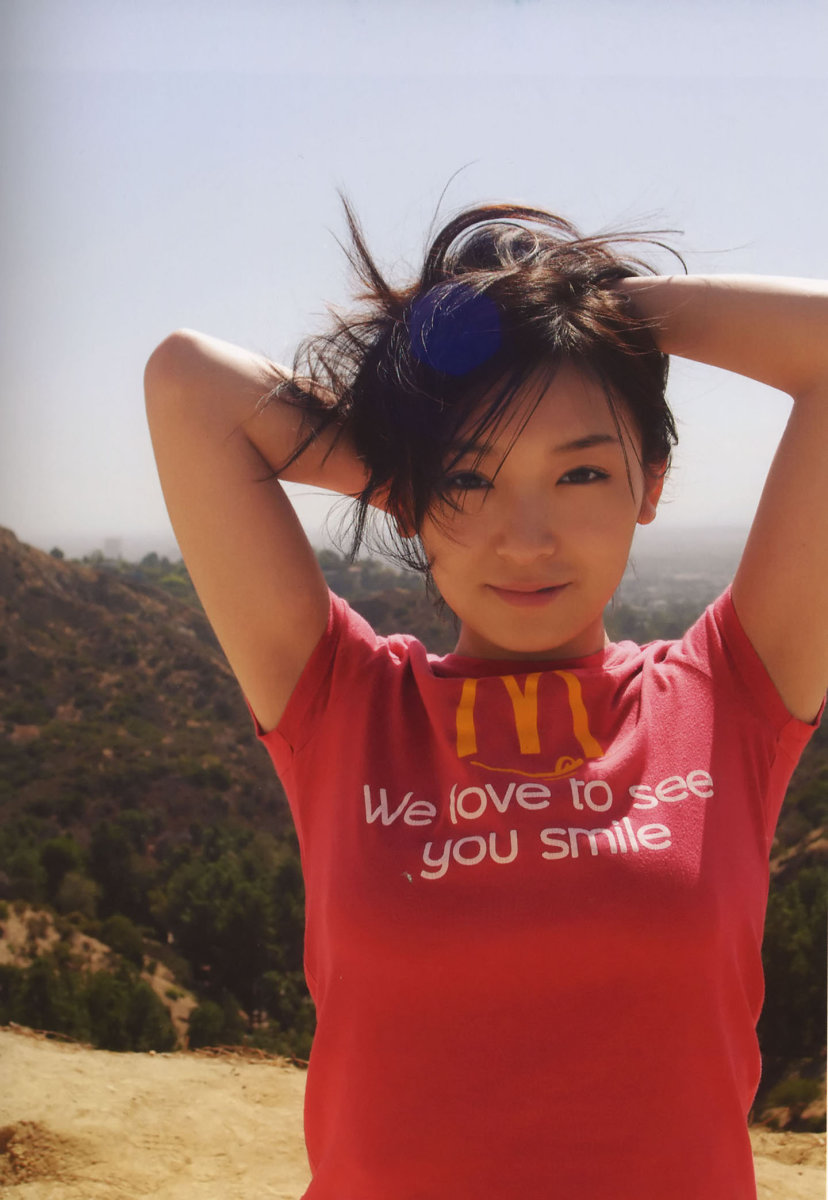 Ai Kago wearing a t-shirt showing the McDonald's famous slogan. Ai Kago looks really cute in this picture!