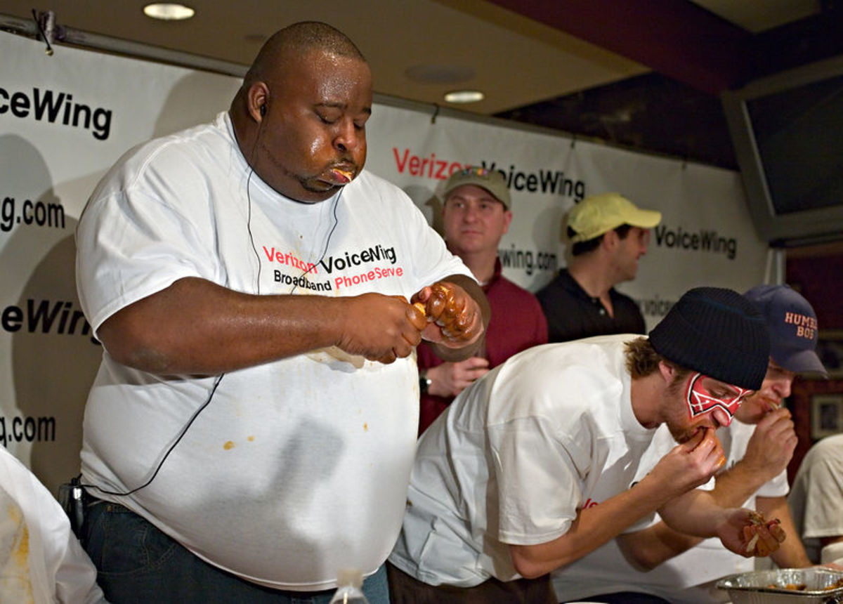 "Eric ""Badlands""  Booker in a Buffalo  Wing Eating  Championship."