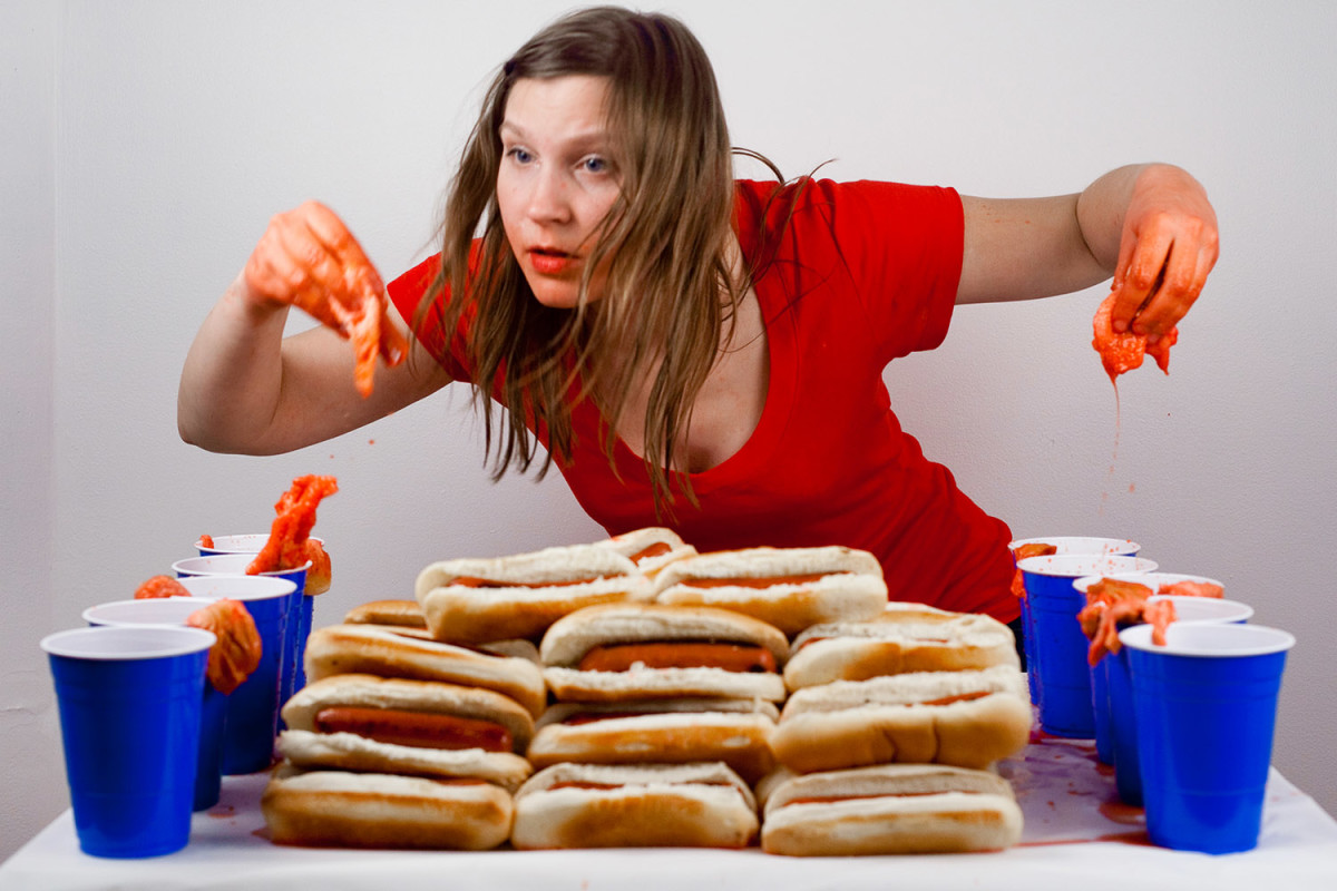 Female competitive eater, Val Bromann, is an expert at putting away the hot dogs.