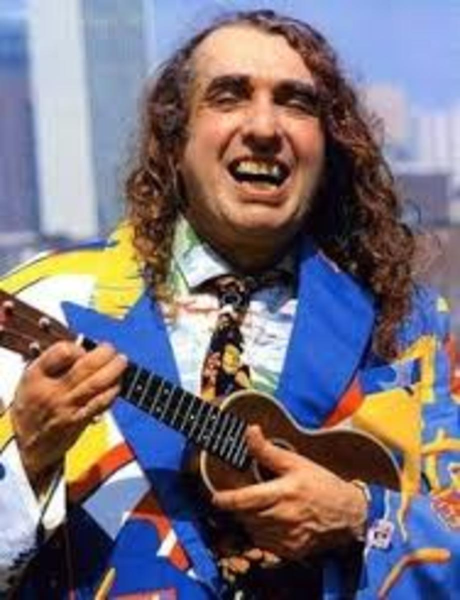 Tiny Tim with a guitar