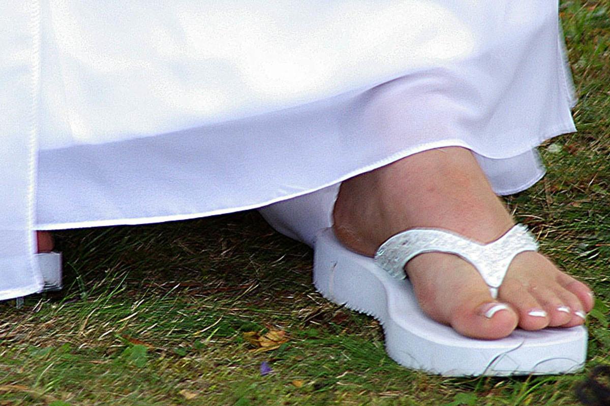 Bride wearing flip flops.