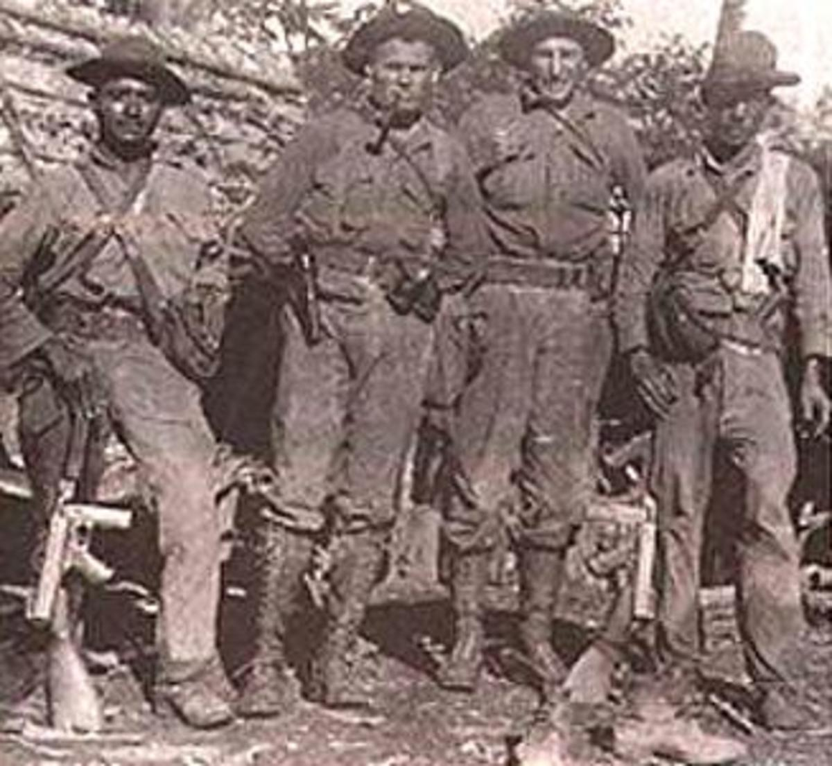 "1st Lieutenant ""Chesty"" Puller (second from left) and Gunnery Sergeant ""Ironman"" Lee (second from right) with a pair of Nicaraguan National Guardsmen, 1931."
