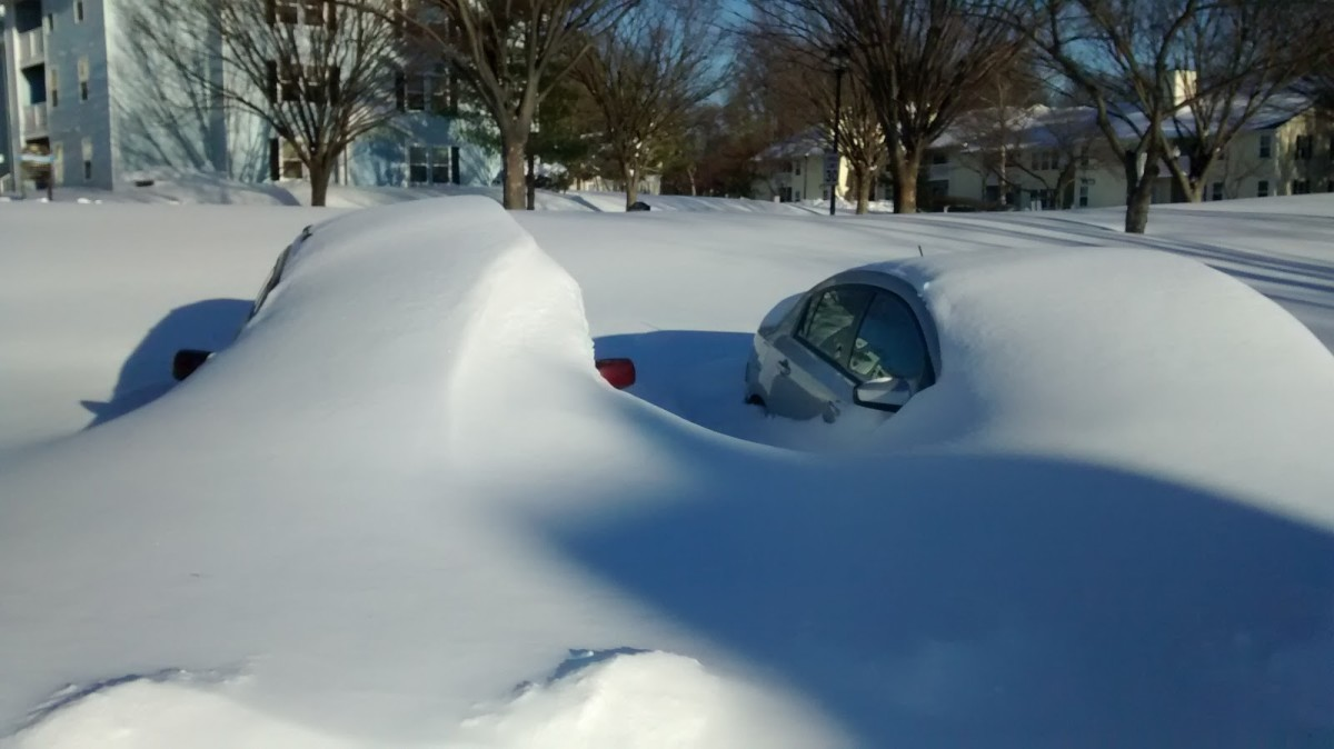 January 23, 2016. After the blizzard, roads and cars in Maryland were buried in the snow.