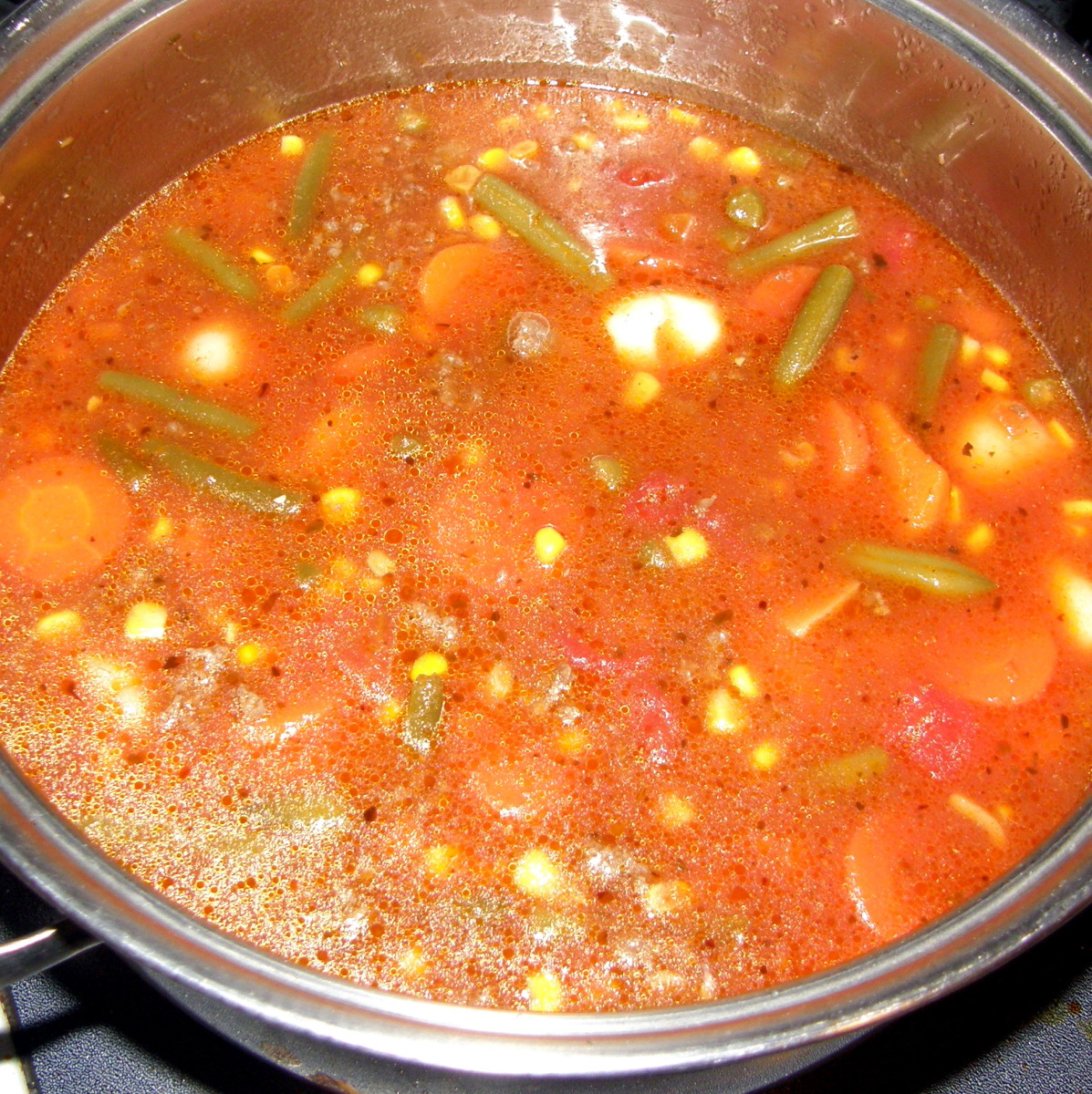 Add the broth.  Gently stir together and let simmer for about 10 minutes. In a small bowl, combine the flour with 2 Tbsp. of water until the flour is completely dissolved & then stir it into the stew. Cover & simmer on low for another 30 minutes (if