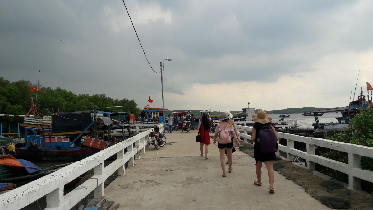 Tourists gather at the dock