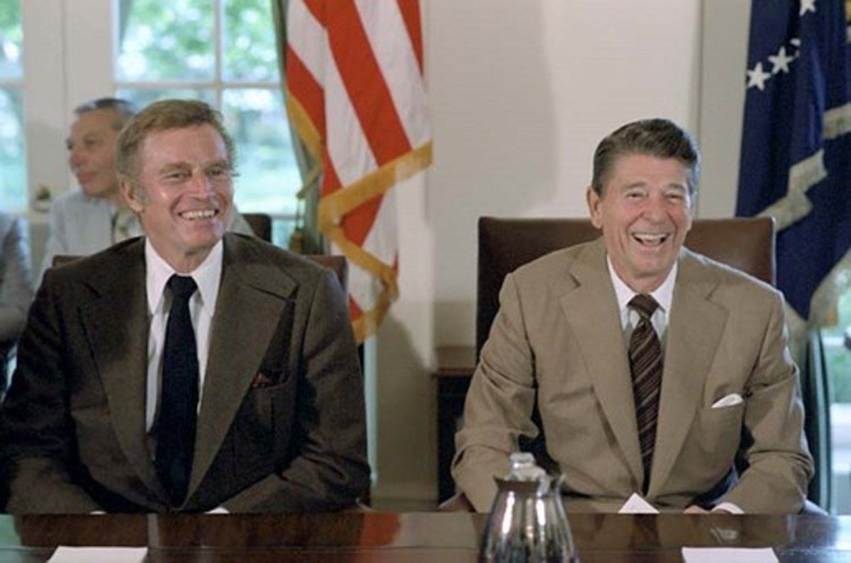 President Reagan seated next to Charlton Heston