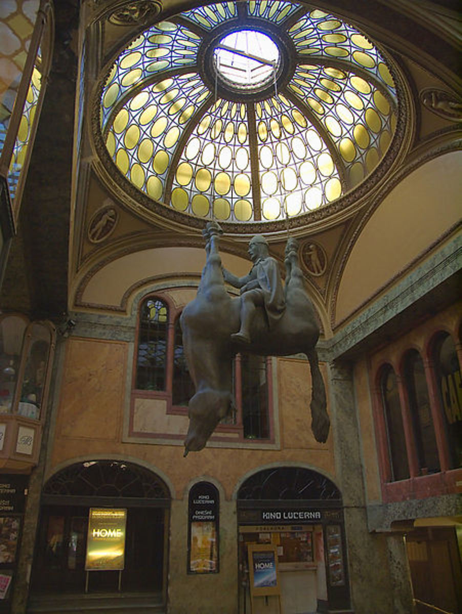 Statue of St. Wenceslas riding an inverted horse. It is located in the entrance to the Lucerna theater on the southeast side of Wenceslas Square. Sculpture by David Cern