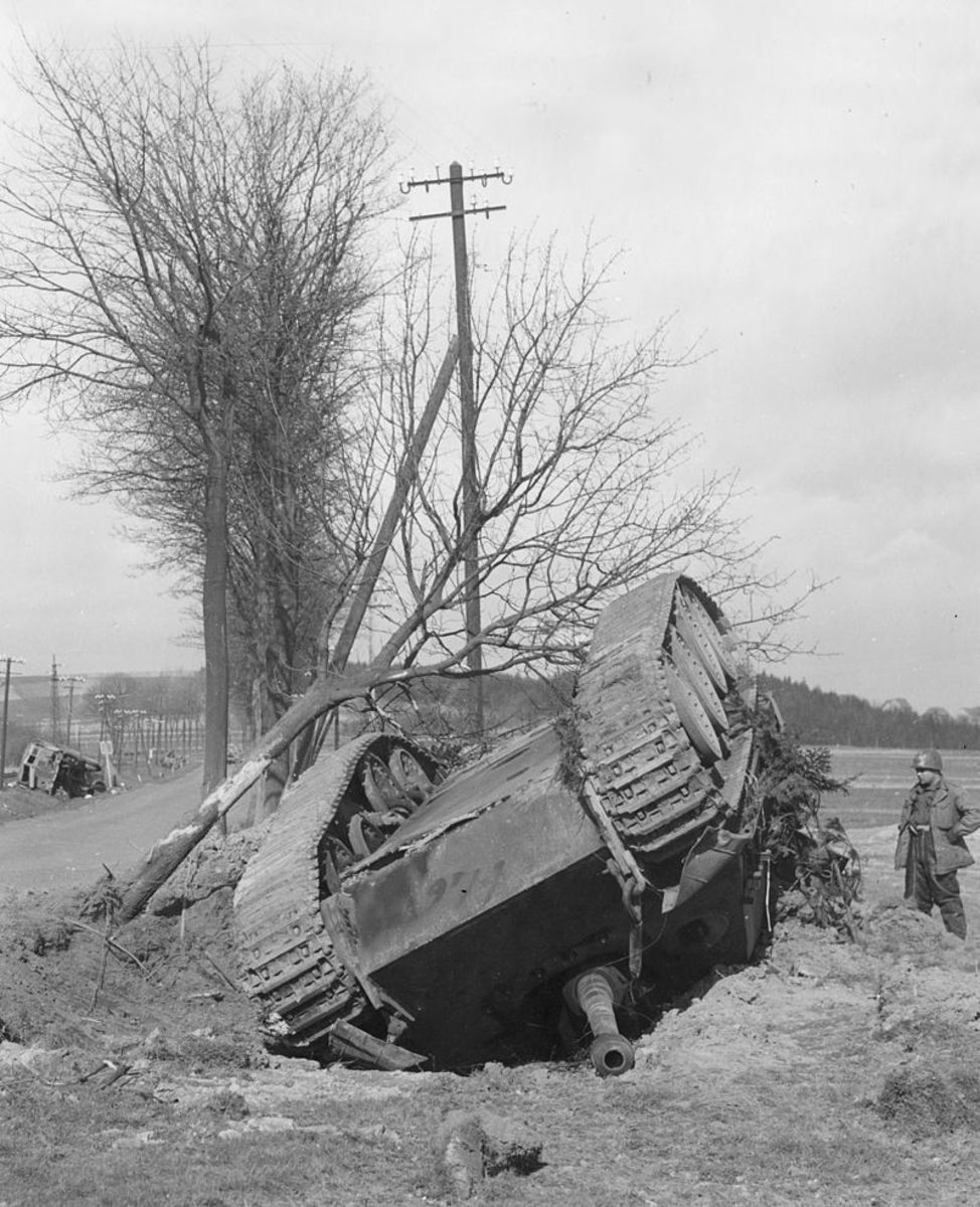 A German Jagdpanther-tank destroyed by air attack near Altenkirchen, Germany. Note another destroyed vehicle across the road.