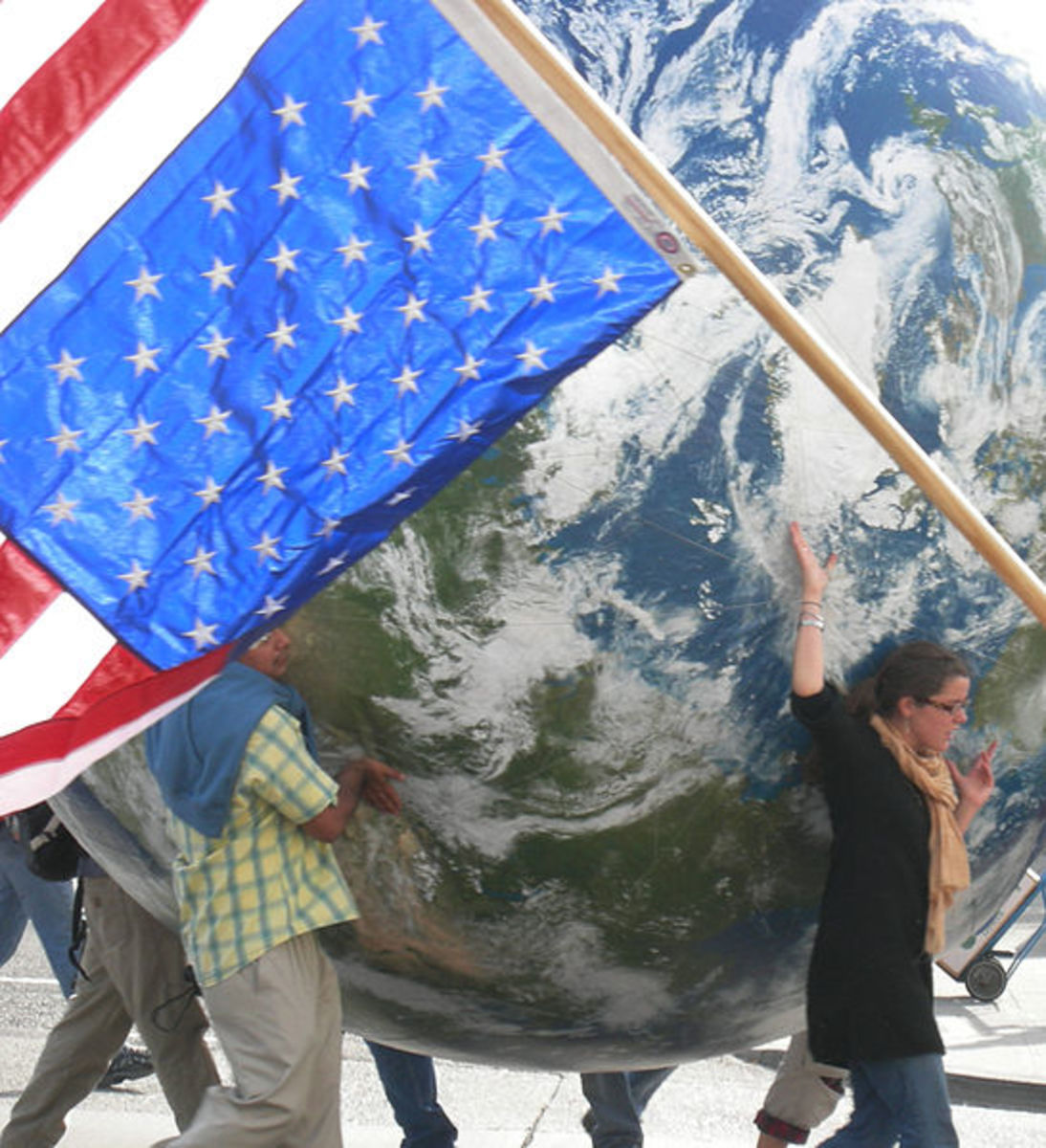 Giant globe and inverted U.S. flag (a signal of distress), anti-war march, Seattle, Washinigton, 27 October 2007.