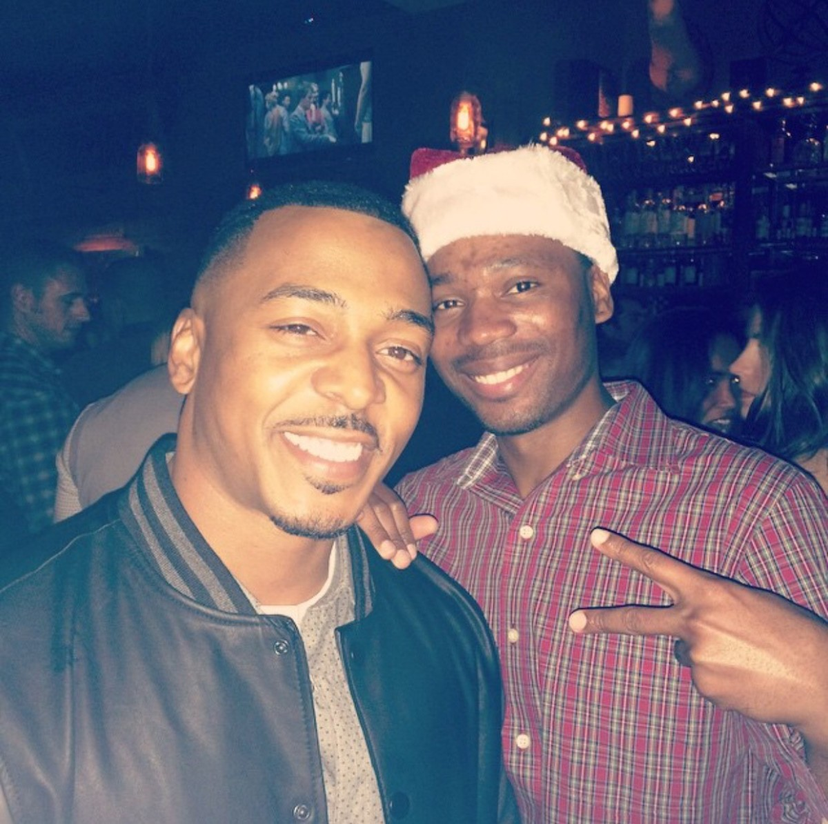 "Tay with client, RonReaco Lee, a cast member on ""Survivors Remorse"" at a J Pervis Talent Agency Christmas party."