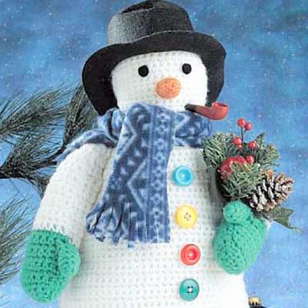 Free crochet pattern Christmas amigurumi snowman.