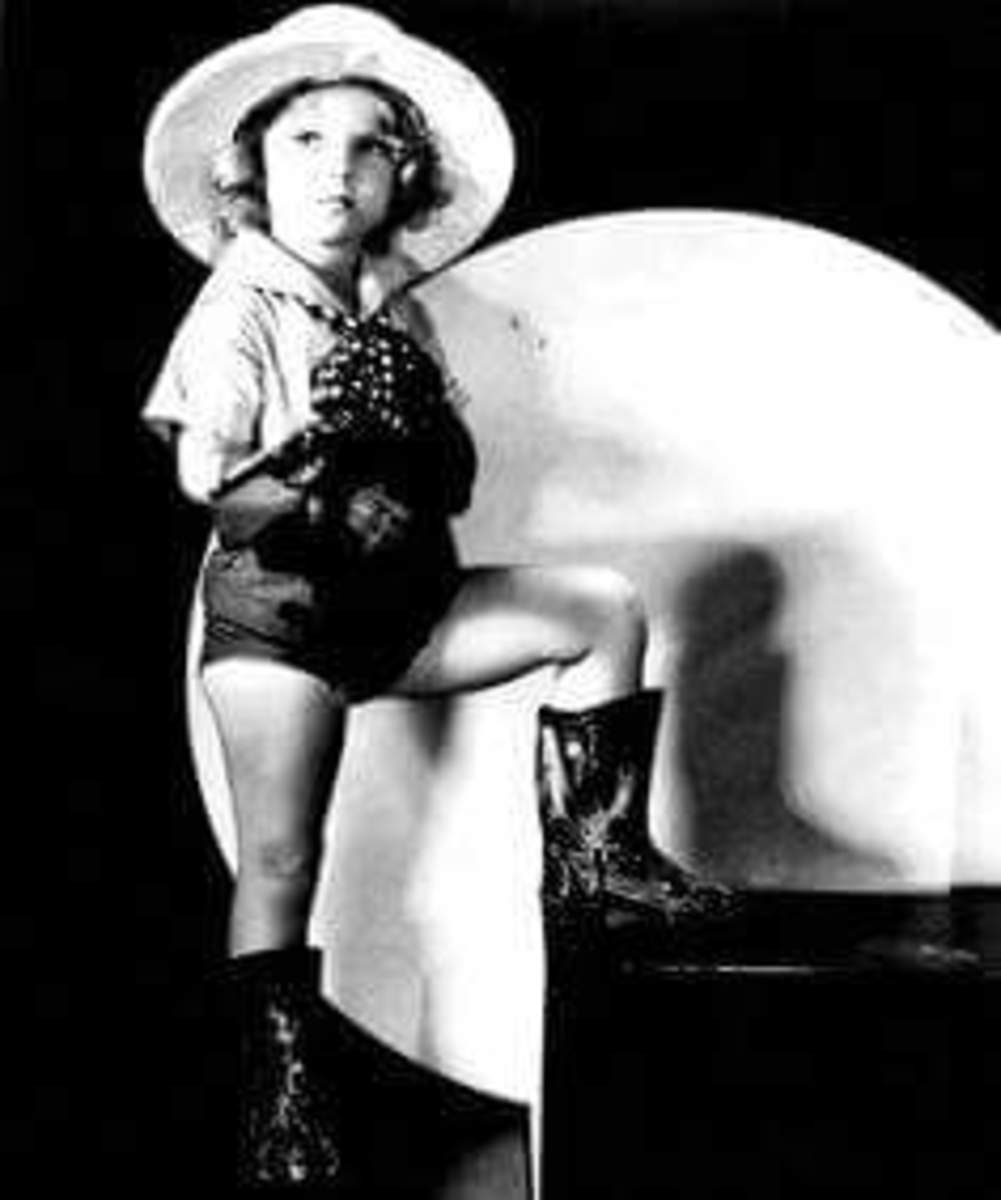 Shirley Temple as Madam Cradlebait.