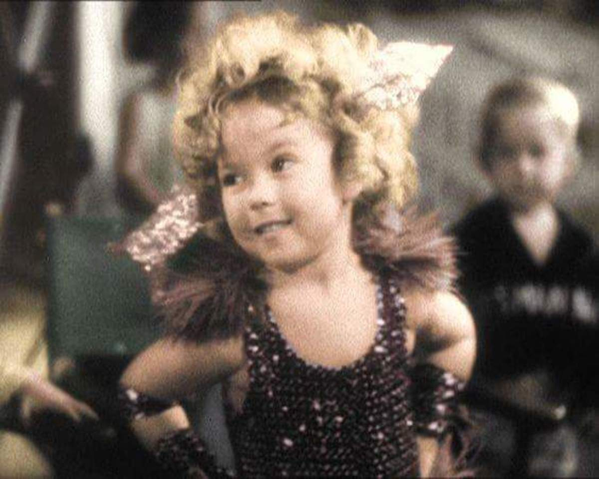 A colored photo of Shirley Temple as Morelegs Sweettrick.