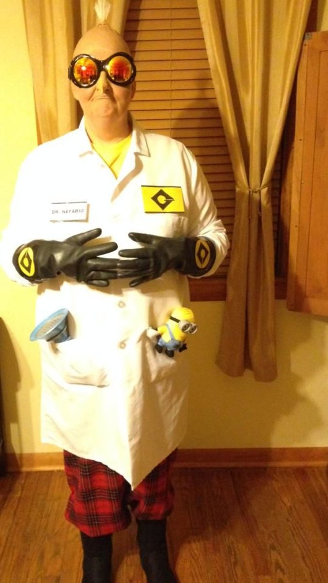 Goggles, name tag, lab insignia, rubber gloves, white lab coat, Minion doll, crazy plaid pants, and a pair of boots