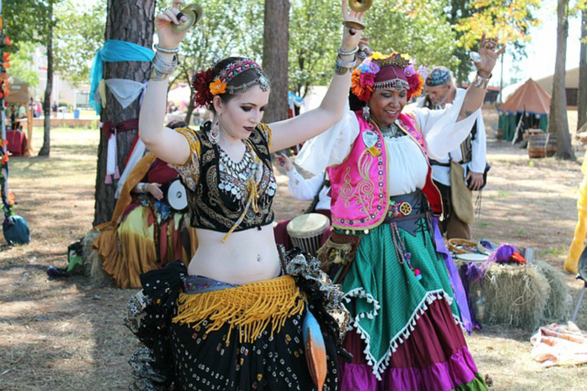 Folkloric costumes being worn at an outdoor event. .