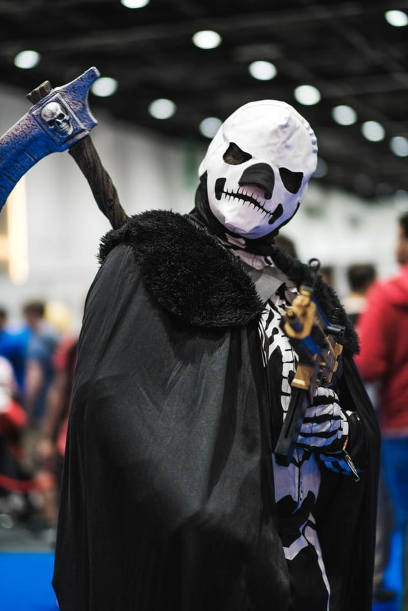 The grim reaper with his sickle in readiness to harvest souls.