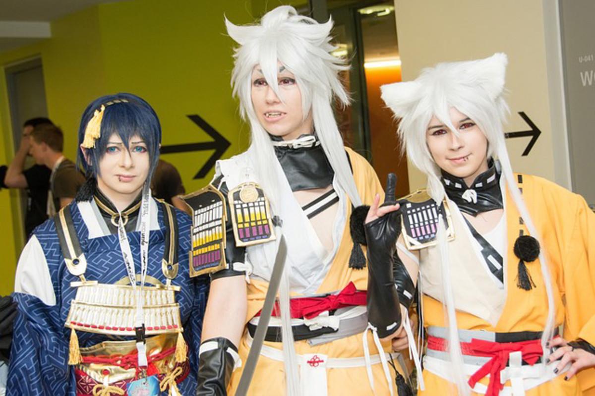 Three people dressed to imitate anime or Manga comic characters.