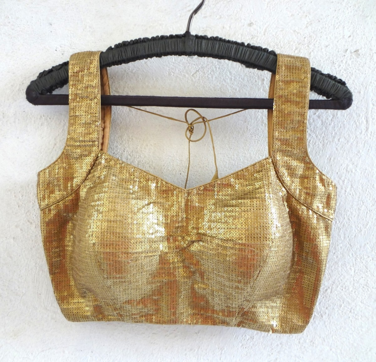 Sexy gold sequin saree blouse design in sleeveless and padded.