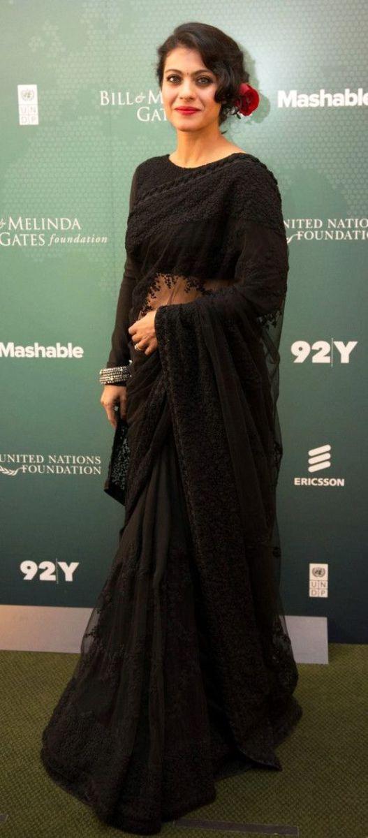 Kajol in black saree with black full sleeve blouse