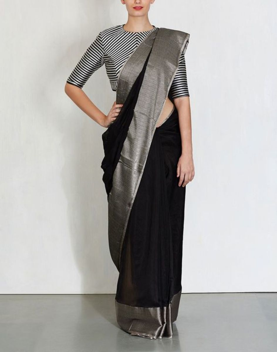 Striped black and white blouse with black saree with grey border