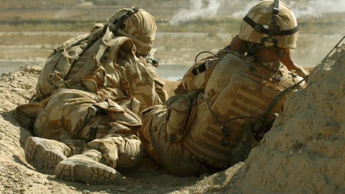A British sniper and his spotter, like a secondman who verifies a hit. Conditions in Afghanistan demanded accurate spotting, as a miss betrayed the sniper's whereabouts