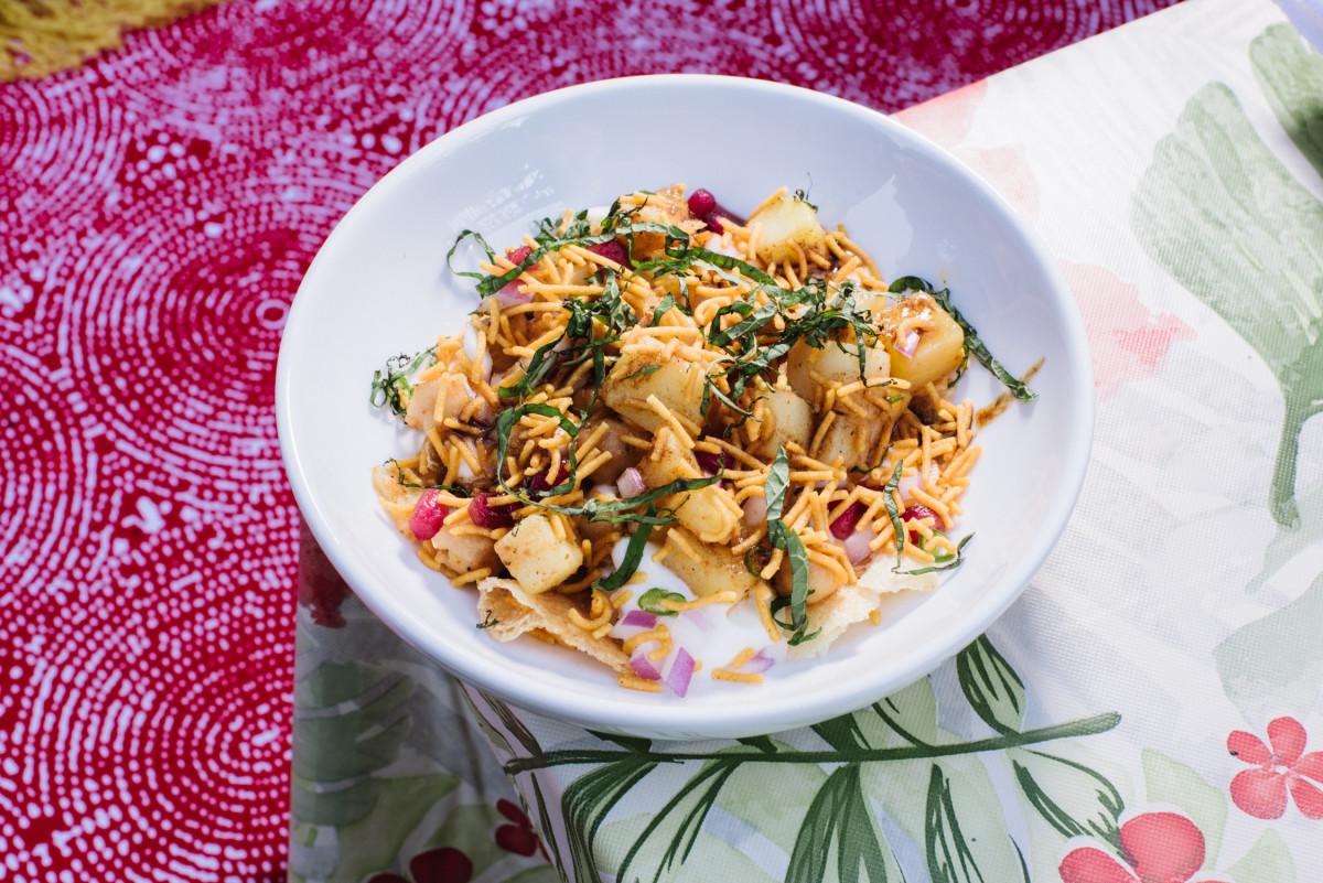 Papri Chaat - Semolina crisps, spiced potatoes, yogurt, onions, chickpeas, mint, tamarind, chaat masala.