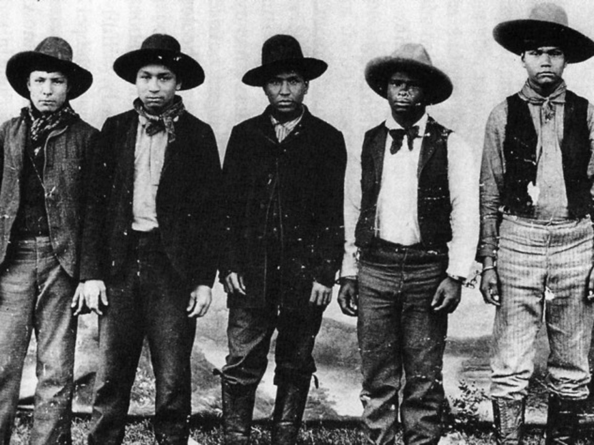 The leader of this gang, Rufus Buck, is in the center.  The son of a black father and a Creek indian mother, he dreamed that his gang's spree would trigger an indian uprising that rid the area of the white people and return the land to the indians.