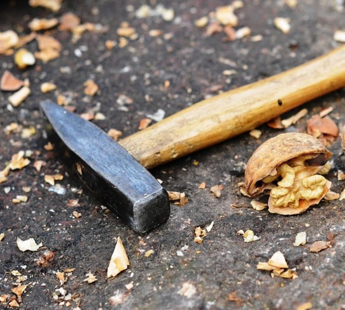 Cracking nut shells to make ink
