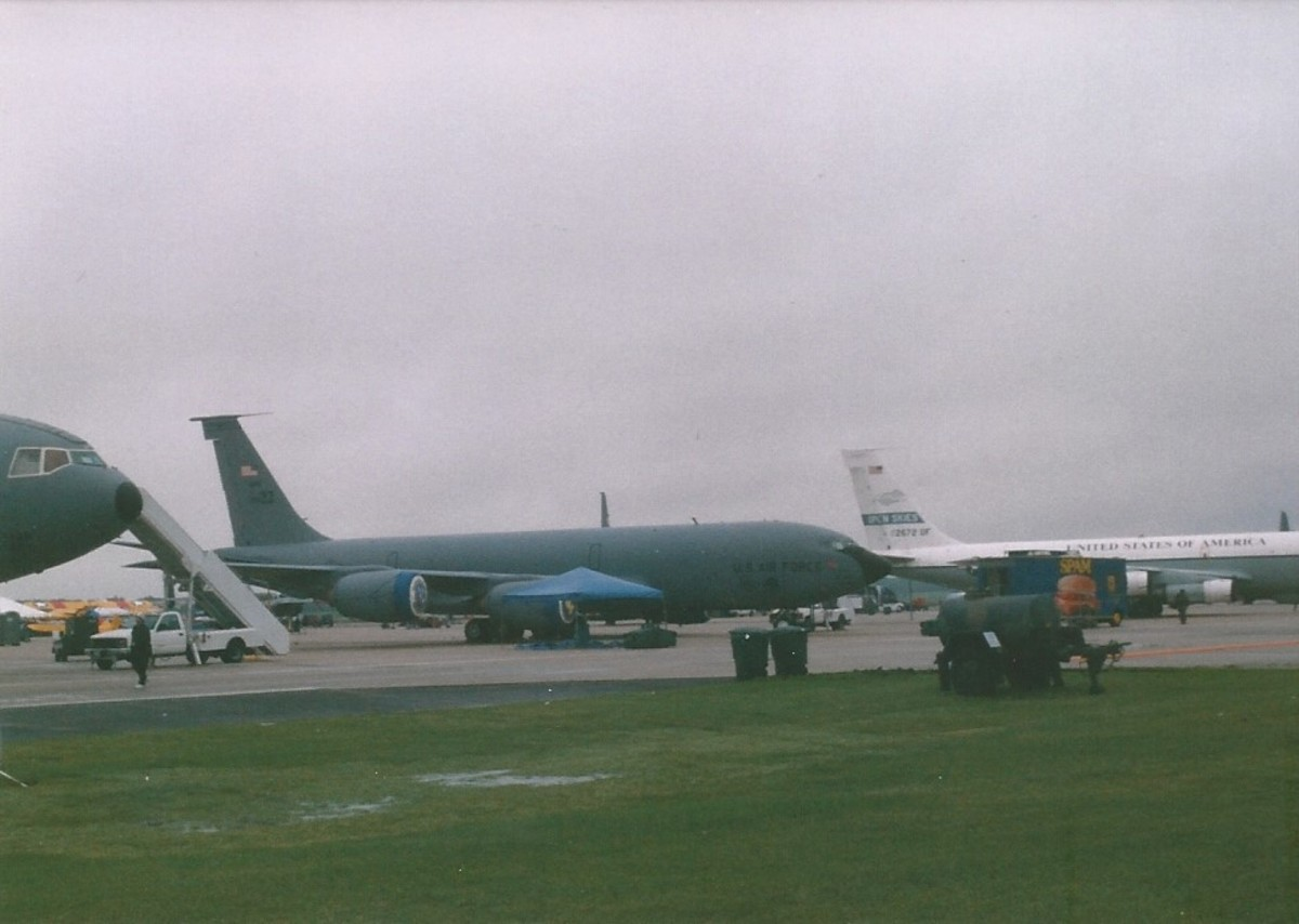 A lineup of C-135s. A KC-135 and an OC-135 in the background.