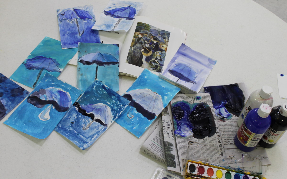 Tints and shades art activity inspired by Renoir's Umbrellas.