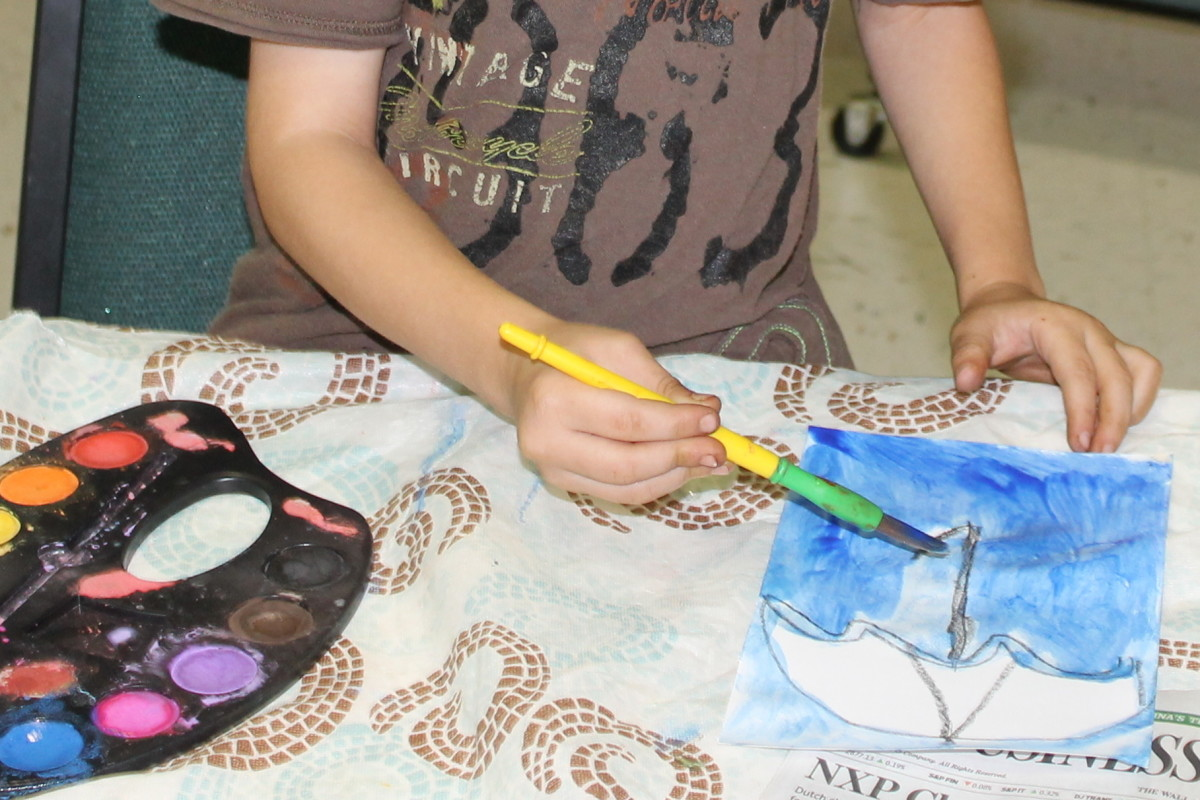 Using watercolor tints and shades of blue watercolor paints to cover the background