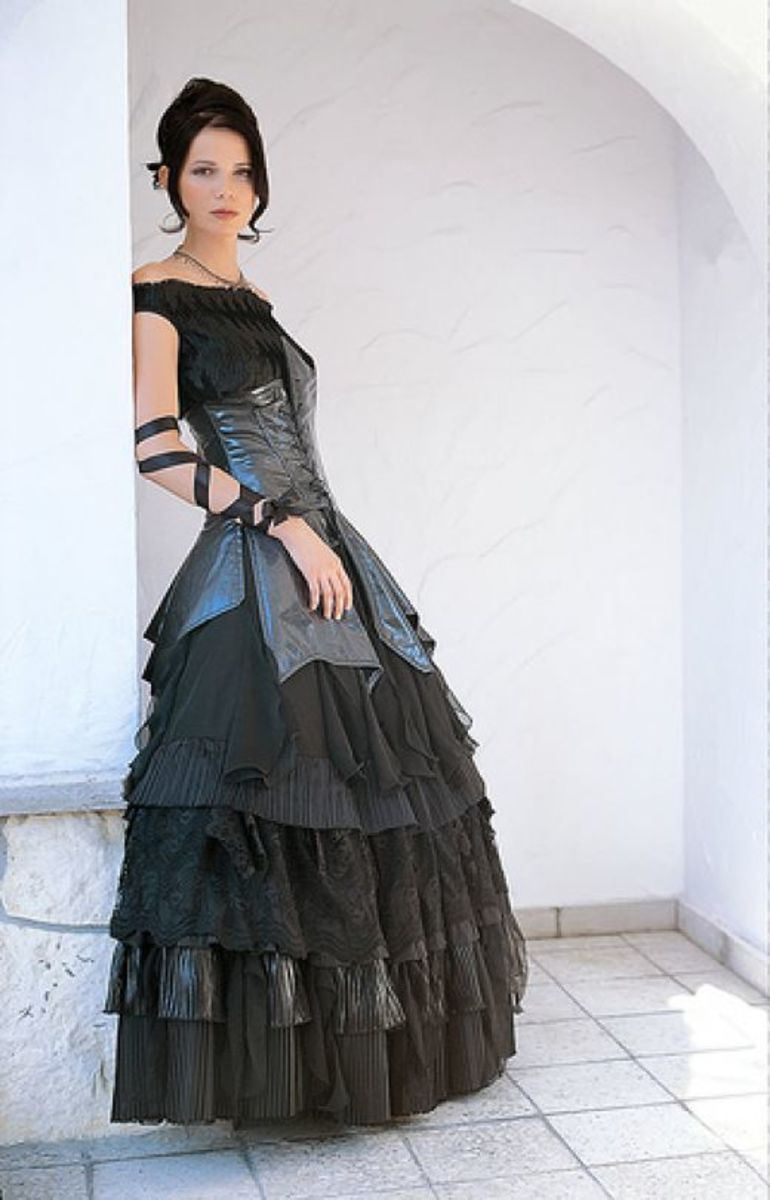 Here is a beautiful black bridal gown featuring organza netting, a leathered bound bodice, and slightly limp full skirt.  This bridal gown would not cost a fortune to make.  Custom made bridal gowns are all the rage.