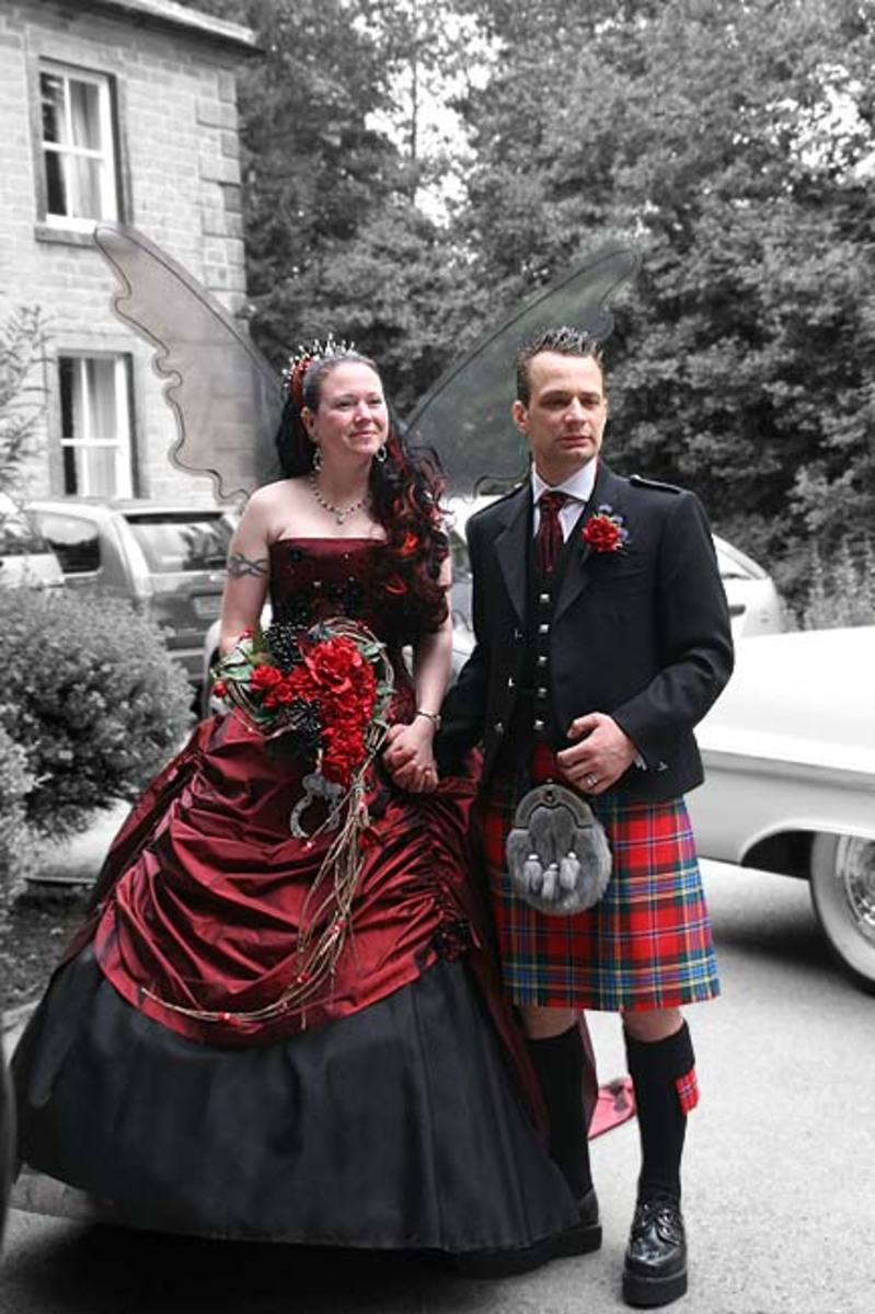 Love the brides smashing red highlights in her hair.  Do not be afraid to mix and match your bridal wear, make up and hair to correspond with your overall Gothic wedding theme.