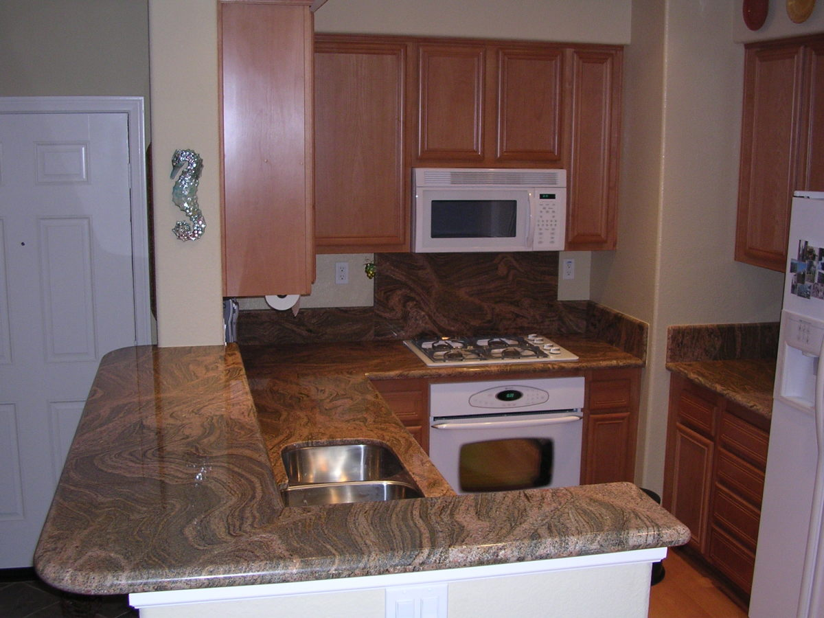 New granite slab countertop in my first home's kitchen - I fell in love with this granite - and still am!