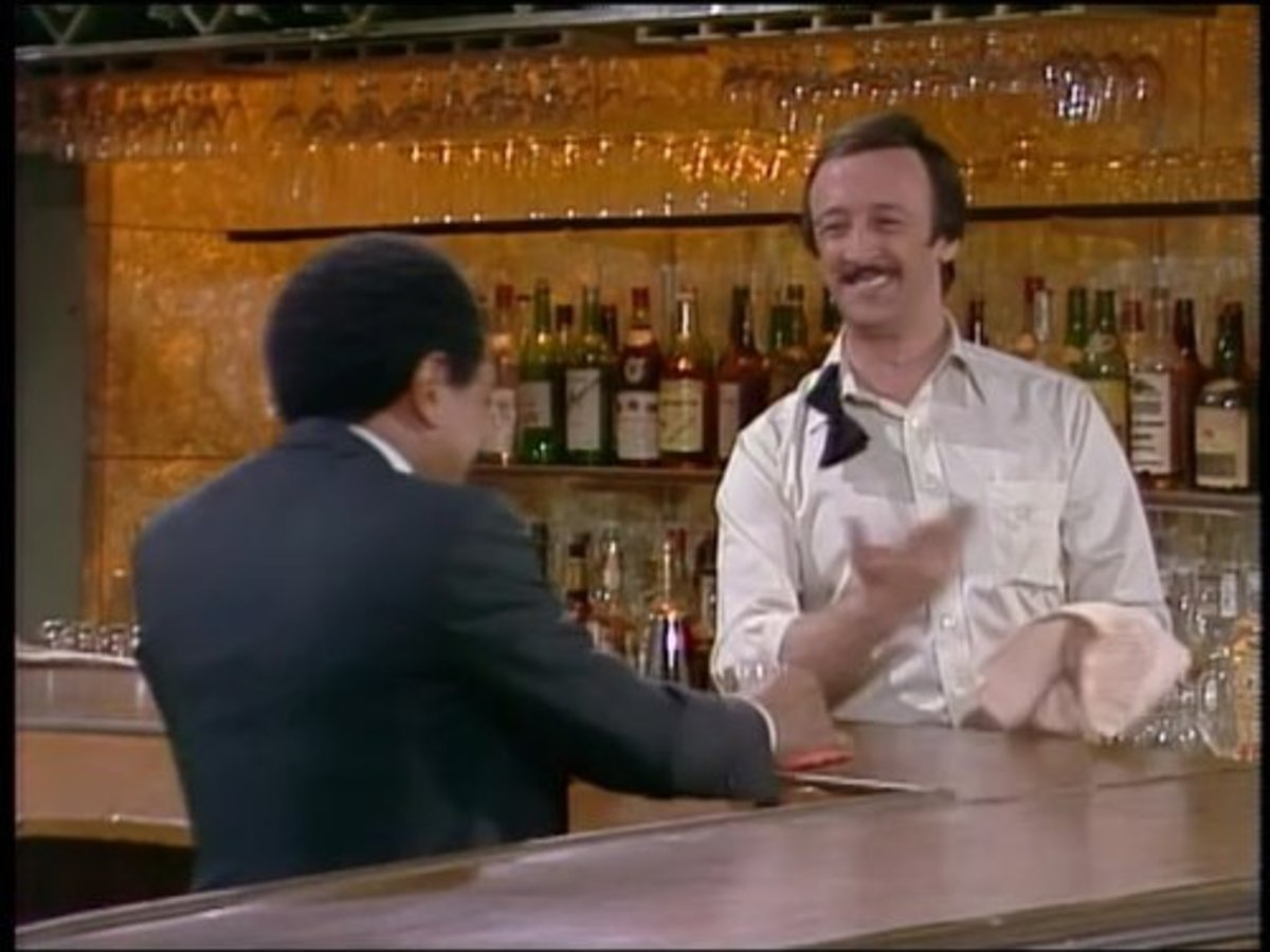 Danny Wells portrayed Charlie, the bartender