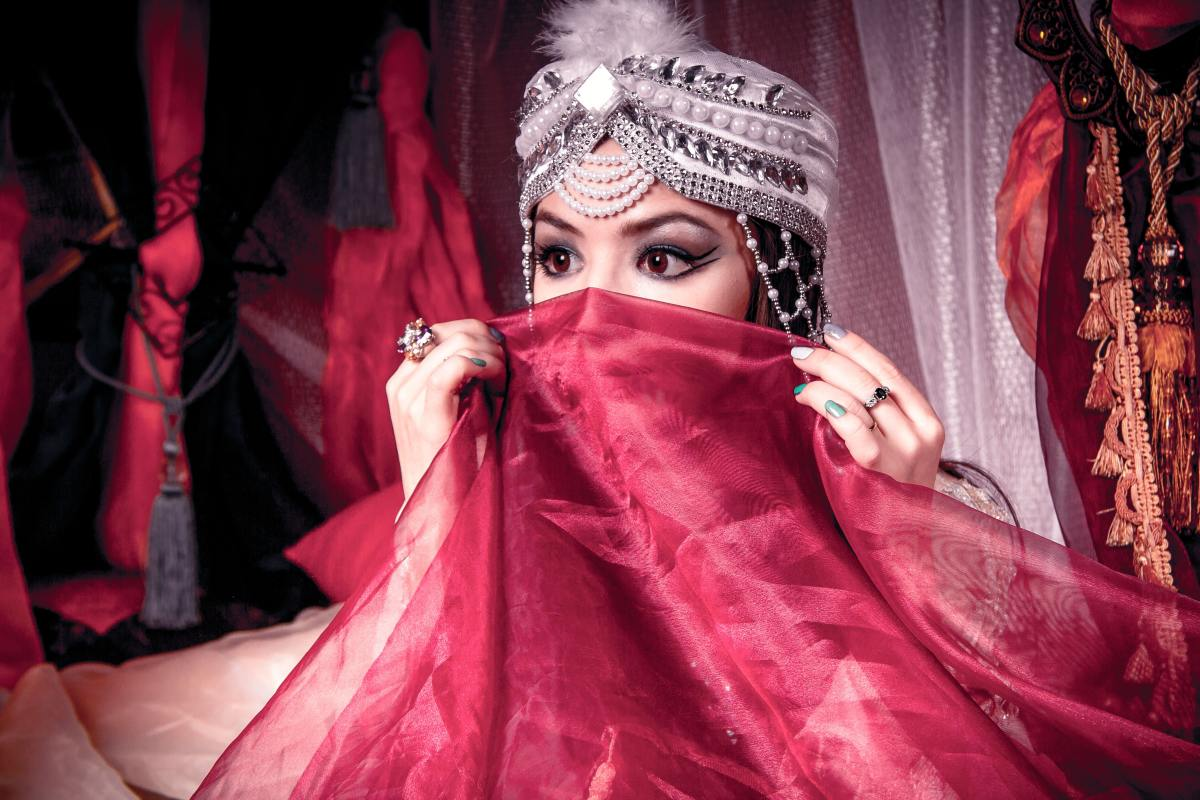 A dancer playing peek-a-boo with her veil..