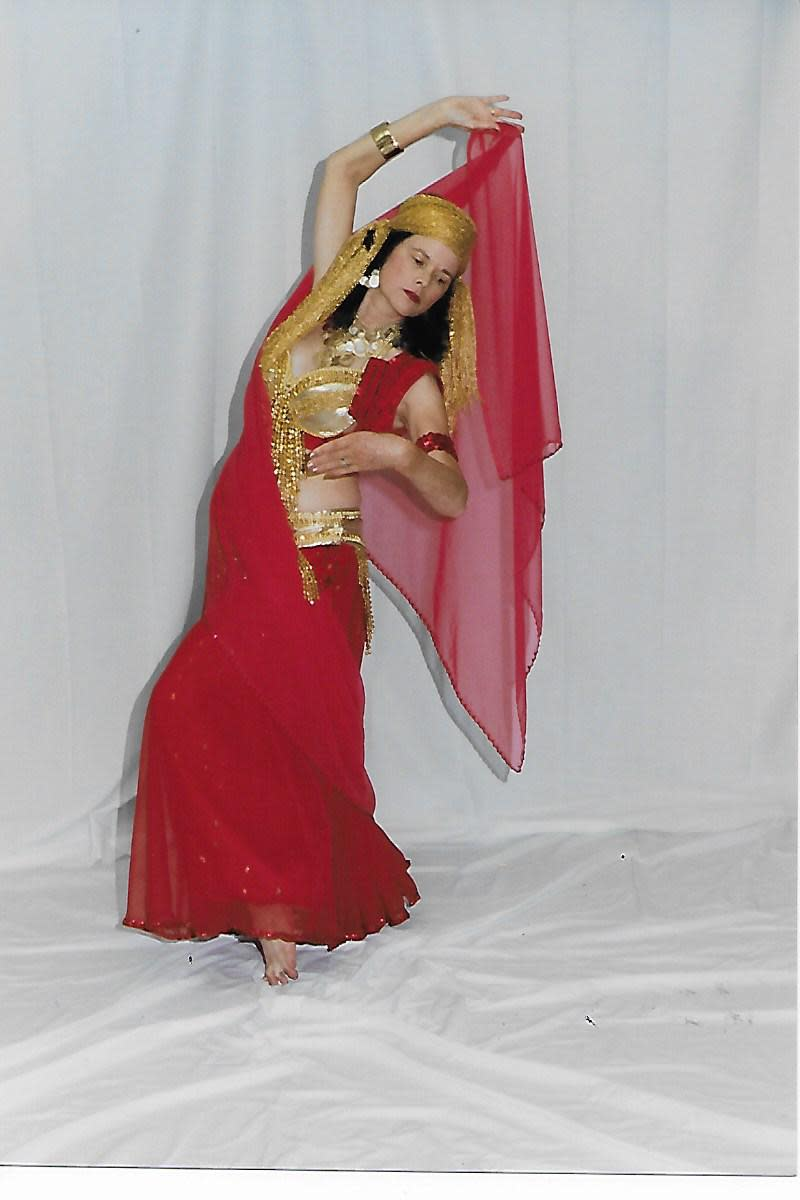 A belly dancer posed with her veil.