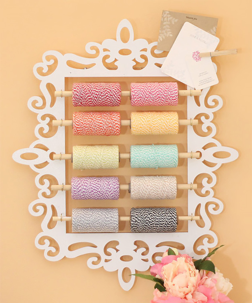 Simple baker twine organizer is easy to make with a few dowels and a wood frame