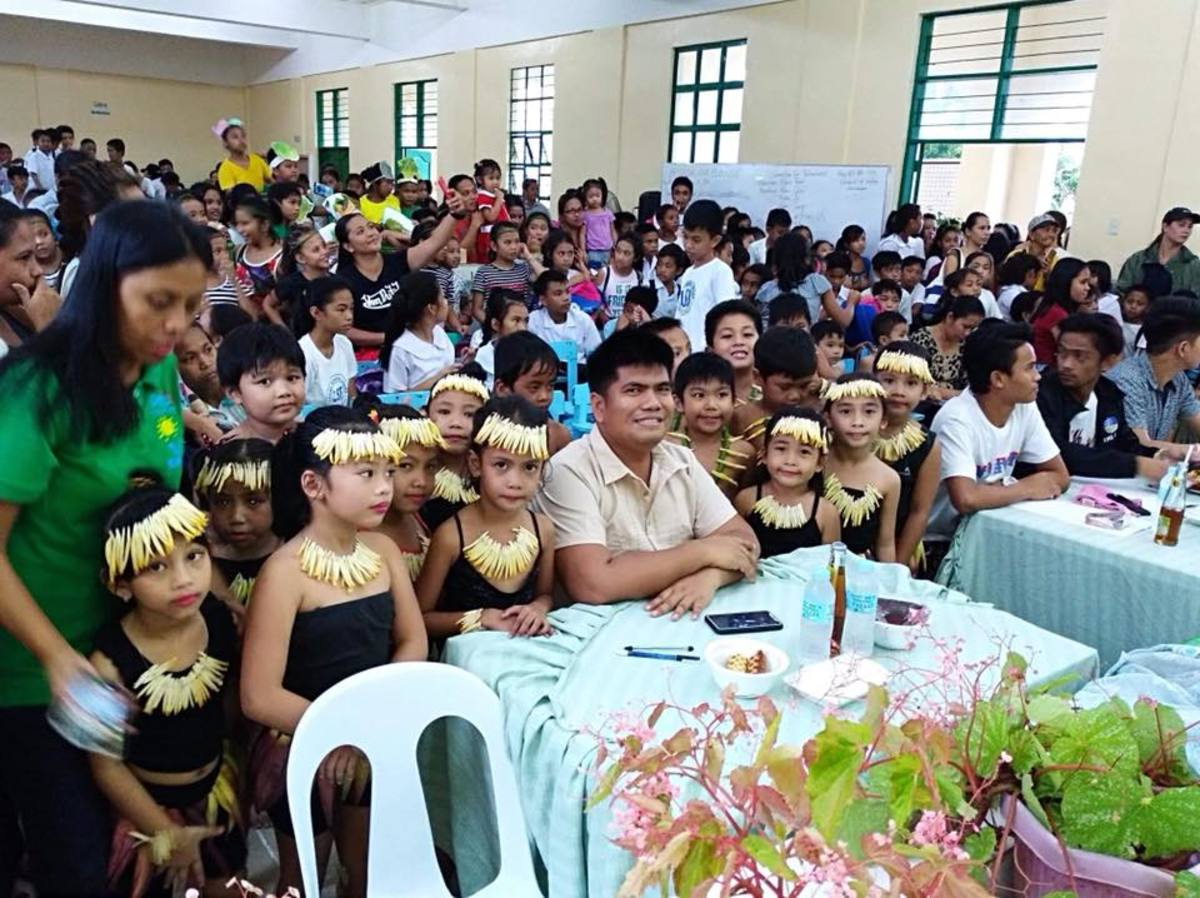 The board of judges together with the Grade I-GT learners during the school-based nutrition month activities in Masinloc Central Elementary School, Masinloc, Zambales.