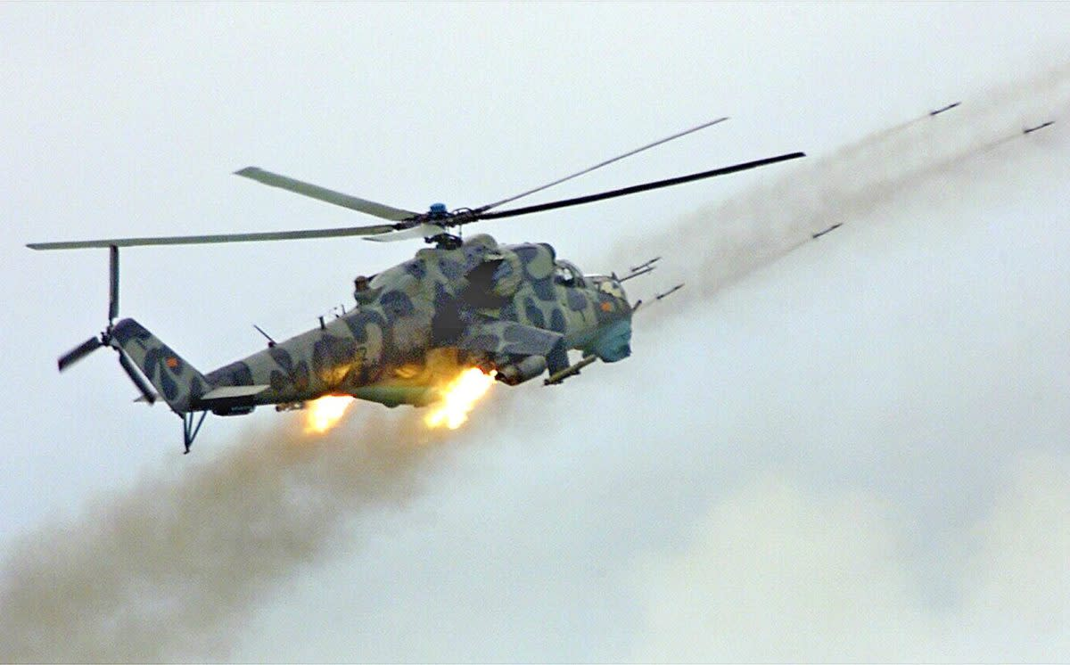 The Mil Mi-24 firing its weapons.
