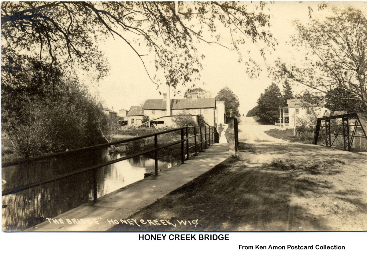 Looking from the Honey Creek Bridge east toward the center of the village.  The building sticking out on the left was the location of the bank.  Photo taken probably in the mid-1930s.