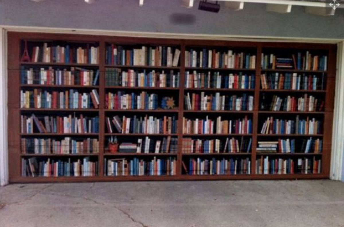 This is the garage door of former writer for the LA Times, Lee Dembart. Dembart loves books so much he had this trompe-l'oeil painted by artist Don Gray in 2005.