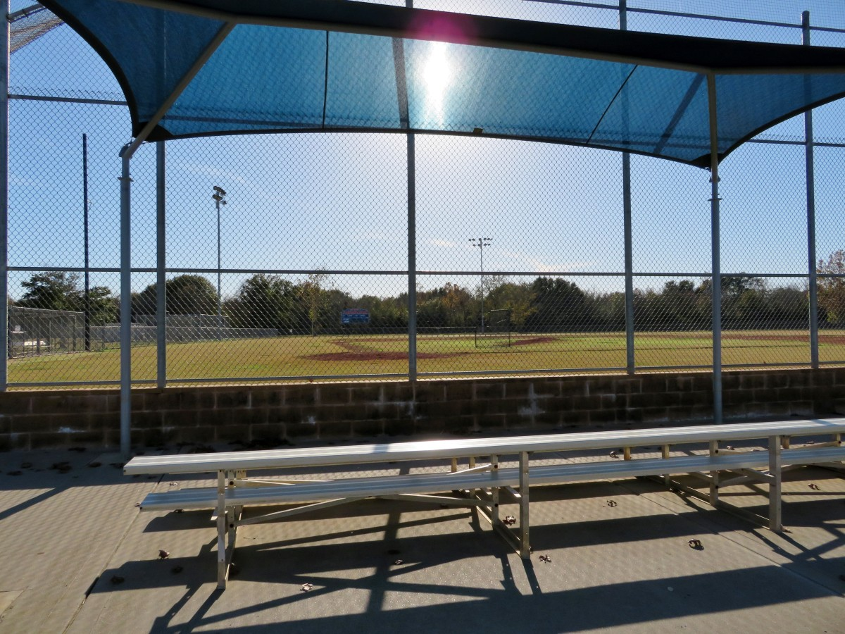 Shaded seating for viewers of baseball games in Freedom Park