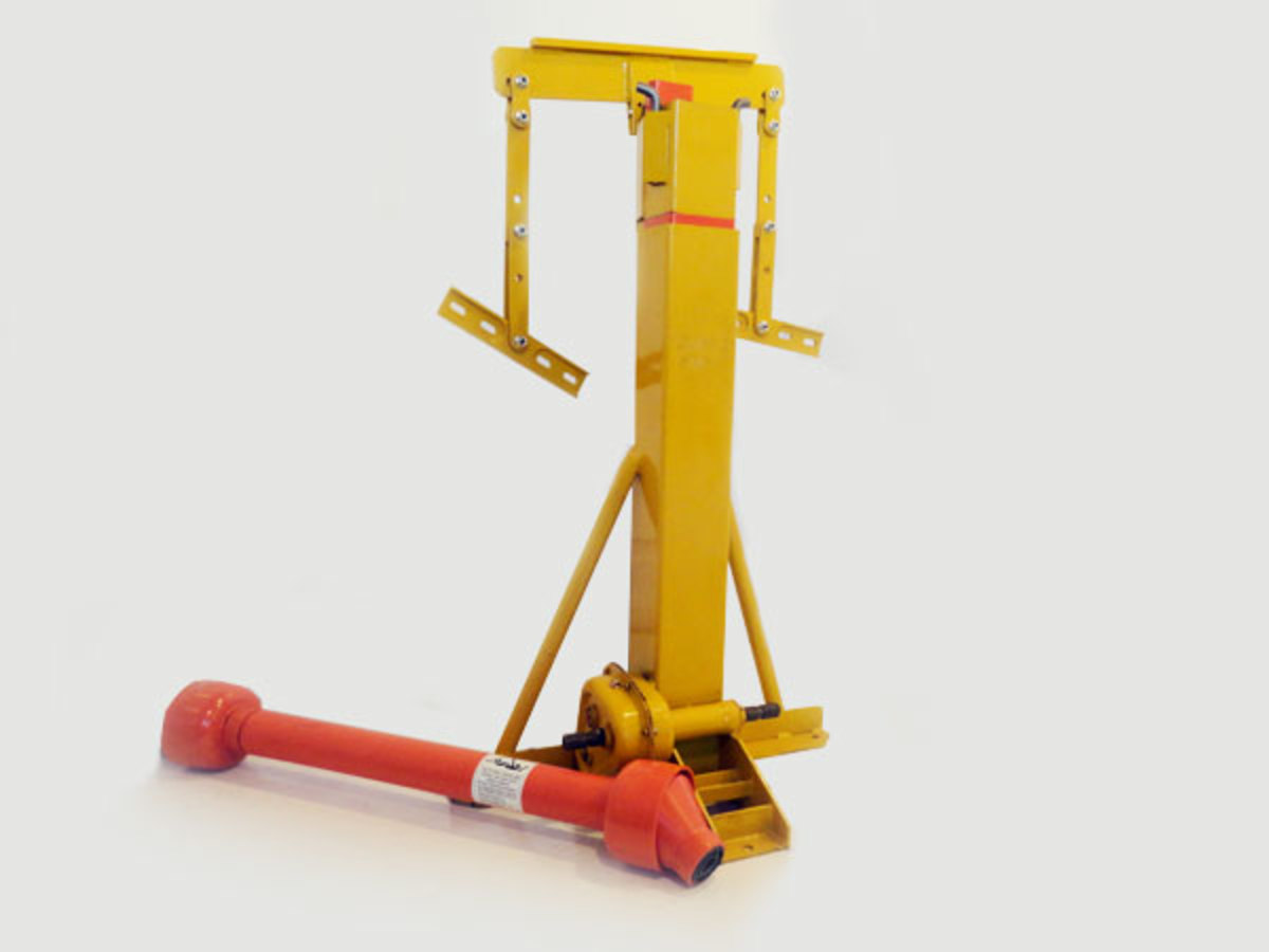 This is a hydraulic grain bin jack. This style is slow to operate, but considered to be among the safest options.