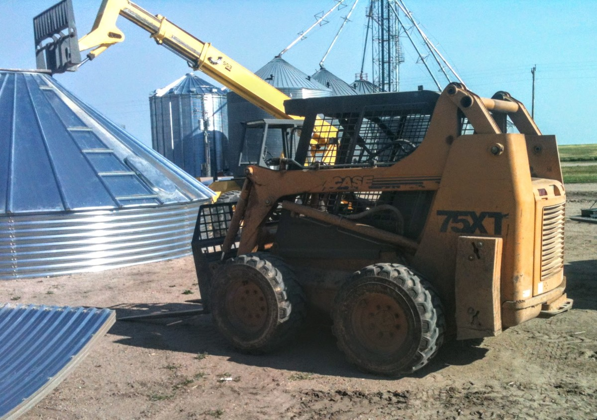 A skid loader makes transportation of bunks of sheets easy and fast. Please allow only experienced skid loader drivers to haul sheets.