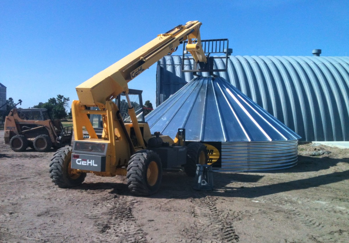 A boom can be extended over the peak of a bin if desired, weighting it against the ground.