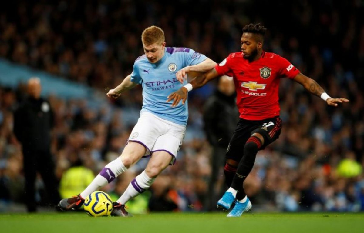 Manchester City (left) and Manchester United (Right) facing off in the Manchester Derby.