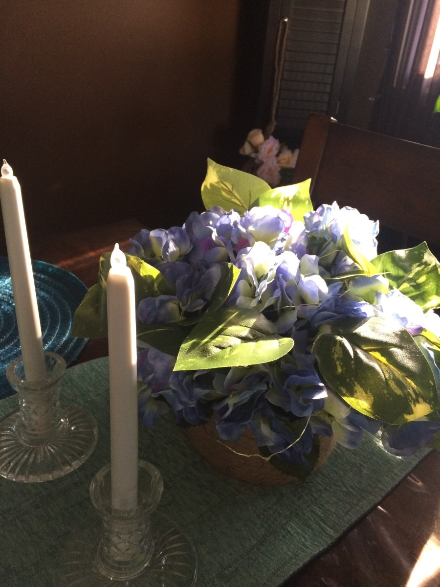 One of my home made dollar tree arrangments with LED candle sticks, also Dollar Tree